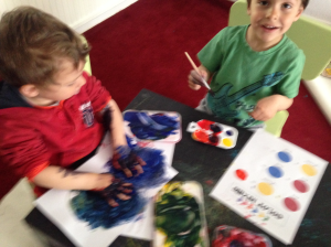 2 boys two paint styles